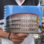 Roberto-showing-me-a-picture-of-the-Colosseum-the-way-it-used-to-be