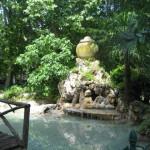 fountain beside water clock