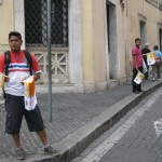 Vendors selling flags for the Wednesday Papal Mass