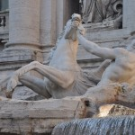 The splashing water of the Trevi fountain can be heard from far away
