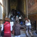 Believers pray while they go up the stairs