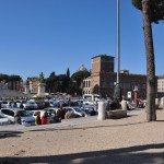 There are benches and stairs beside the Trajans column for you to take a rest
